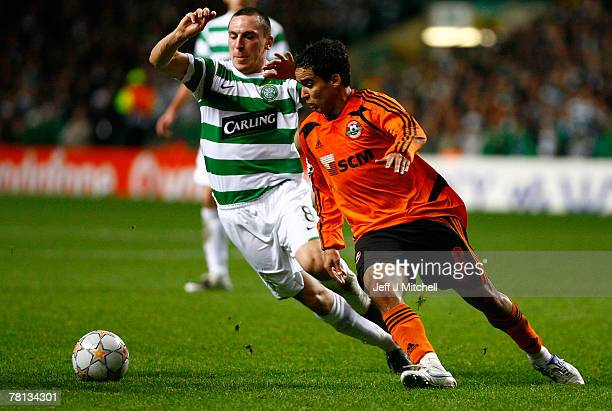 Scott Brown of Celtic tackles Jadson of Shakhtar Donetsk during the UEFA Champions League match between Celtic and Shakhtar Donetsk at Celtic Park...