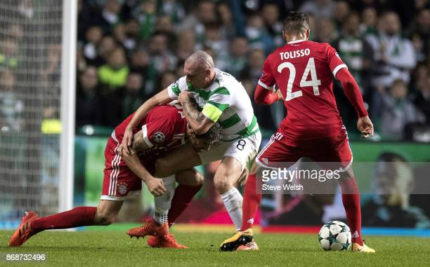 Scott Brown of Celtic tackles Javi Martinez of Bayern Muenchen during the Champions League group B match between Celtic FC and Bayern Muenchen at...
