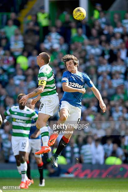 Scott Brown of Celtic tackles Joey Barton of Rangers during the Ladbrokes Scottish Premier league match between Celtic and Rangers at Celtic Park at...