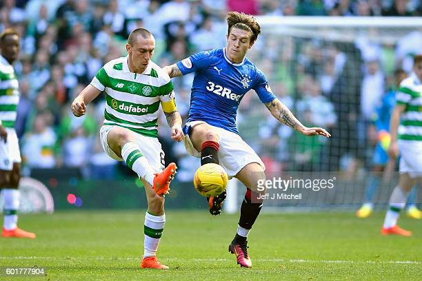 Scott Brown of Celtic tackles Josh Windass of Rangers during the Ladbrokes Scottish Premier league match between Celtic and Rangers at Celtic Park at...
