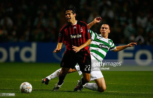 Scott Brown of Celtic tackles Kaka of AC Milan during the UEFA Champions League match between Celtic and AC Milan at Celtic Park October 3 2007 in...