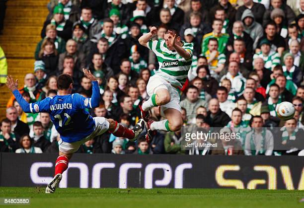 Scott Brown of Celtic tackles Lee McCulloch of Rangers during the Scottish Premier League match between Celtic and Rangers at Celtic Park on February...