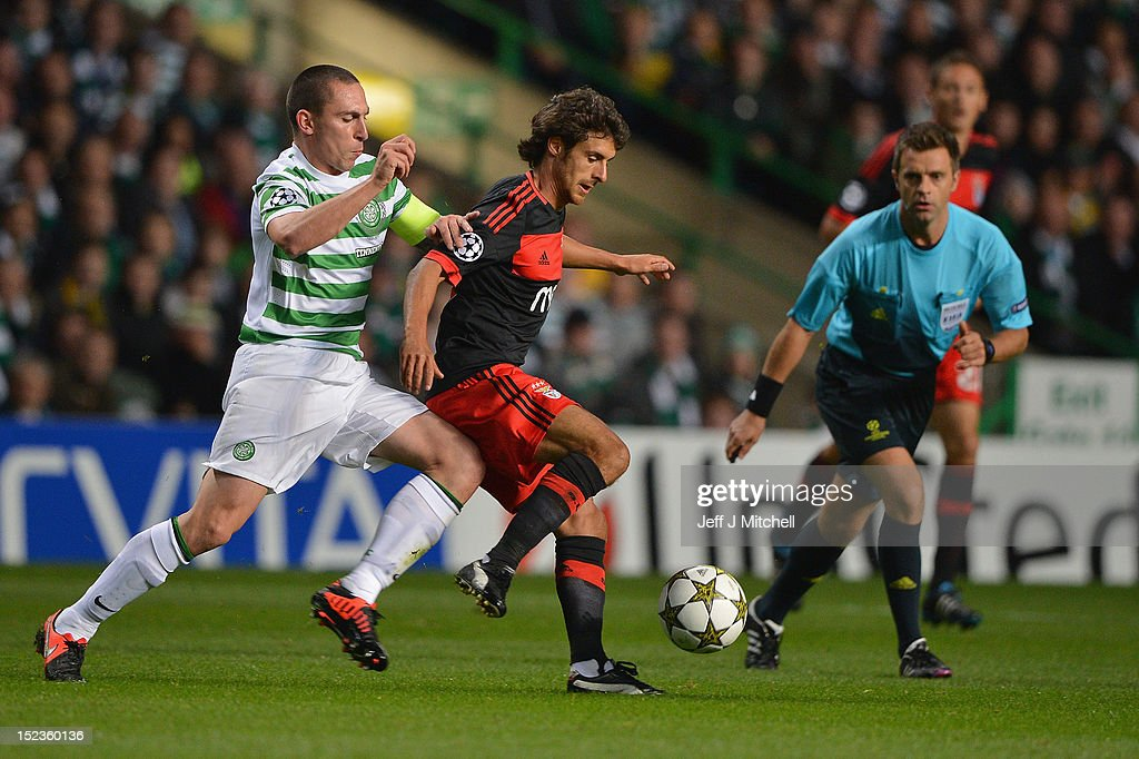 Scott Brown of Celtic tackles Pablo Aimar of SL Benfica during the UEFA Champions League Group G match between Celtic and SL Benfica at Celtic Park on September 19, 2012 in Glasgow, Scotland.