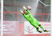 Scott Brown of Cheltenham Town makes a save from a free kick by Craig Bellamy of Cardiff City during thre Pre Season match between Cheltenham Town...