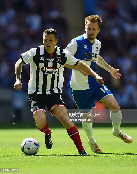 Scott Brown of Grimsby Town evades Chris Lines of Bristol Rovers during the Vanarama Conference Playoff Final match between Grimsby Town and Bristol...