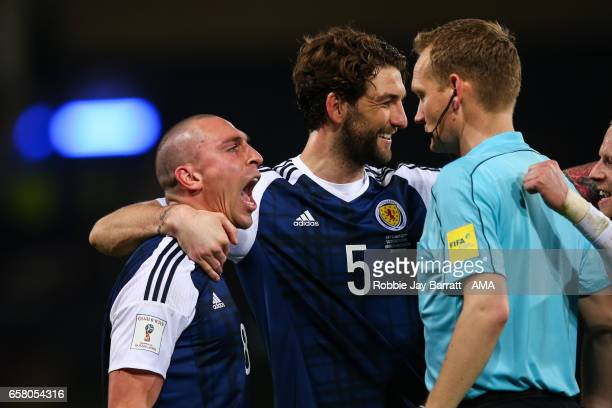 Scott Brown of Scotland celebrates in the lines mans face at full time during the FIFA 2018 World Cup Qualifier between Scotland and Slovenia at...