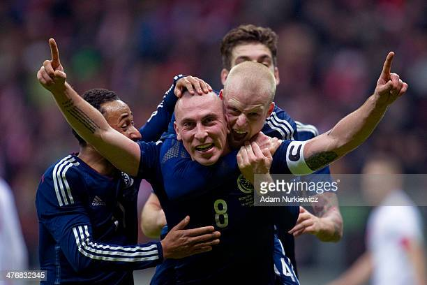 Scott Brown of Scotland celebrates with team mates after scoring the only goal of the match during the international friendly soccer match between...