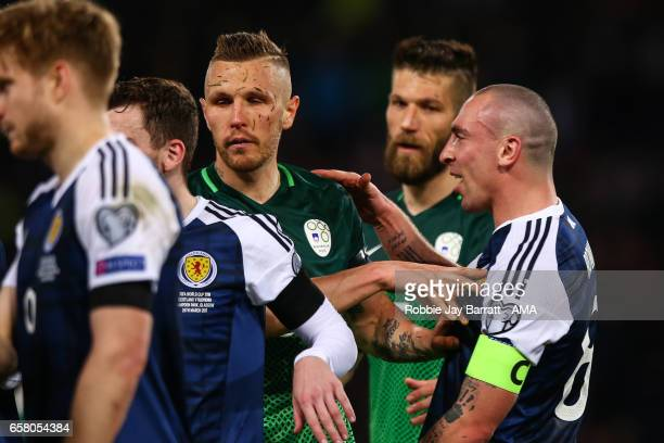 Scott Brown of Scotland has a disagreement with Jasmin Kurtic of Slovenia at full time during the FIFA 2018 World Cup Qualifier between Scotland and...