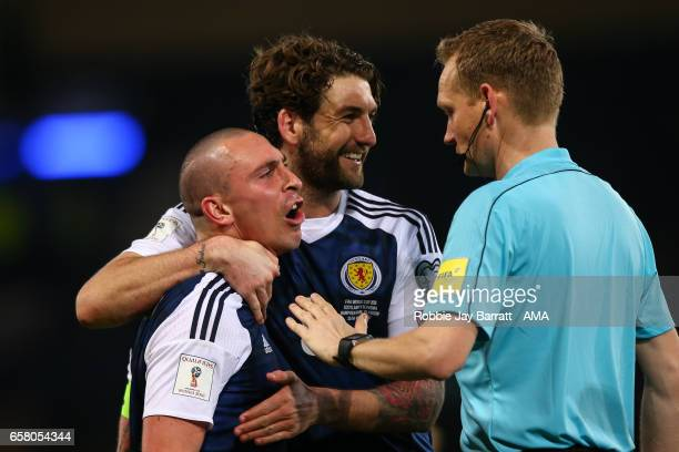Scott Brown of Scotland has a disagreement with the lines man at full time during the FIFA 2018 World Cup Qualifier between Scotland and Slovenia at...