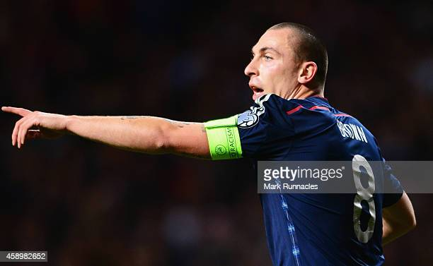 Scott Brown of Scotland points during the EURO 2016 Group D Qualifier match between Scotland and Republic of Ireland at Celtic Park on November 14...