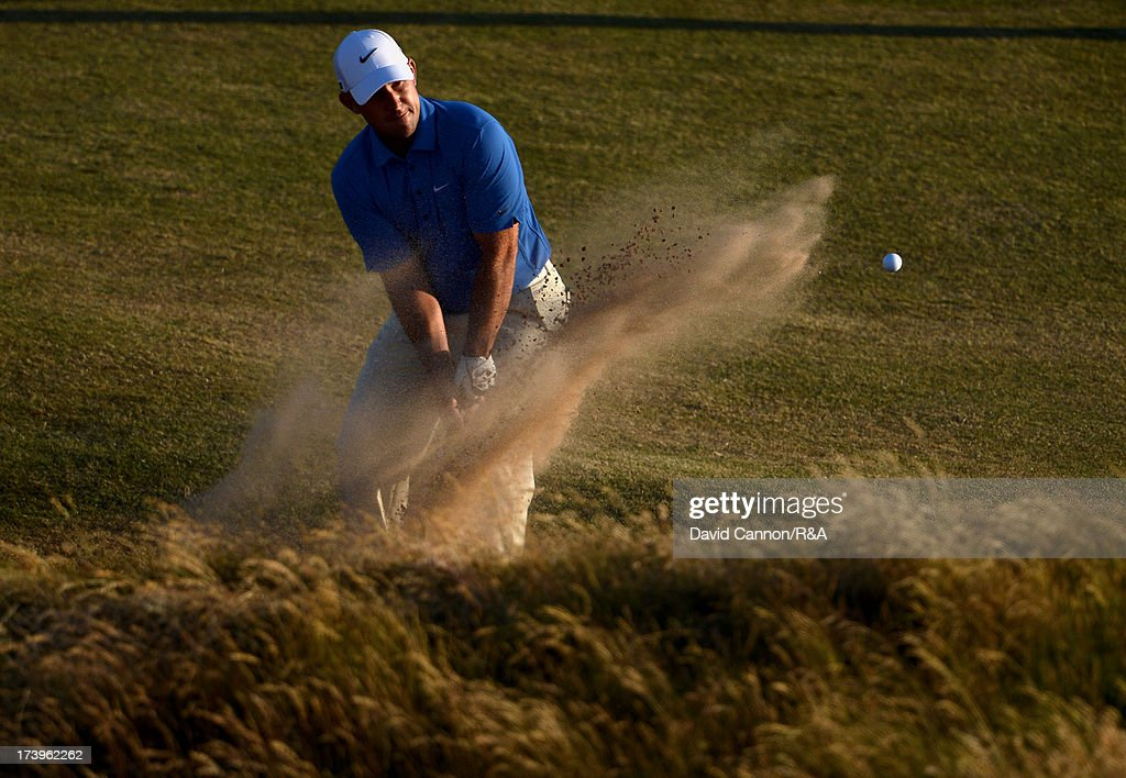 Scott Brown of the United States plays out of bunker on the 17th hole during the first round of the 142nd Open Championship at Muirfield on July 18, 2013 in Gullane, Scotland.