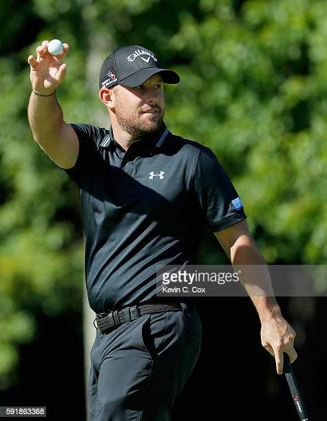 Scott Brown reacts to a putt on the 13th hole during the first round of the Wyndham Championship at Sedgefield Country Club on August 18 2016 in...