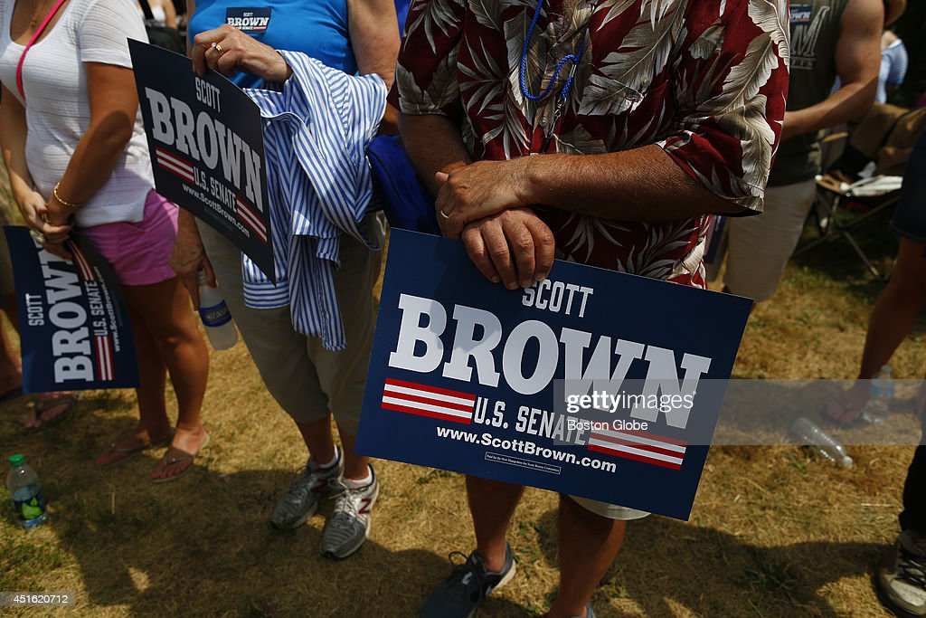 Scott Brown supporters hold signs during a campaign event at Bittersweet Farm in Stratham, New Hampshire July 2, 2014.