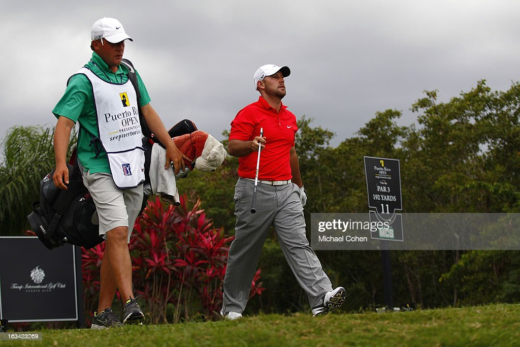Scott Brown (R) walks off the tee box on the 11th hole during the third round of the Puerto Rico Open presented by seepuertorico.com held at Trump International Golf Club on March 9, 2013 in Rio Grande, Puerto Rico.