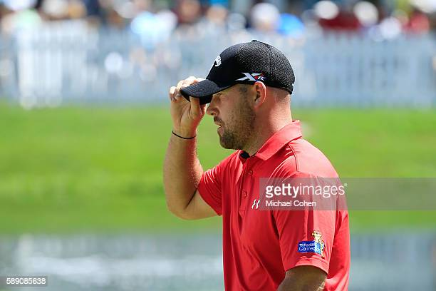 Scott Brown walks on the 18th hole during the continuation of the second round of the John Deere Classic at TPC Deere Run on August 13 2016 in Silvis...