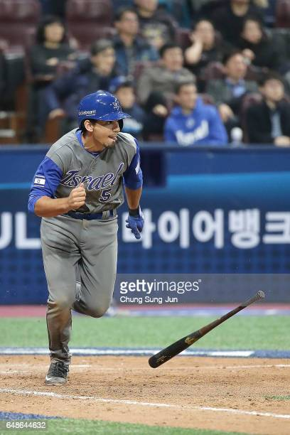 Scott Burcham of Israel hits a RBI single scoring Mike Meyers in the tenth inning of the World Baseball Classic Pool A Game One between Israel and...