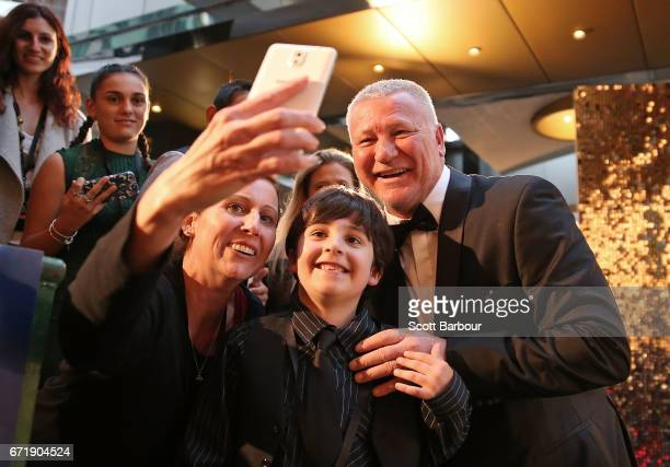 Scott Cam takes a selfie with a fan in the crowd as he arrives at the 59th Annual Logie Awards at Crown Palladium on April 23 2017 in Melbourne...