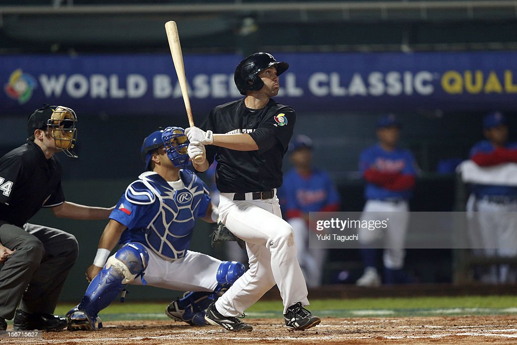 Scott Campbell #13 of Team New Zealand hits a sacrifice fly in the top of the third inning during Game 5 of the 2013 World Baseball Classic Qualifier against Team Philippines at Xinzhuang Stadium in New Taipei City, Taiwan on Saturday, November 17, 2012.