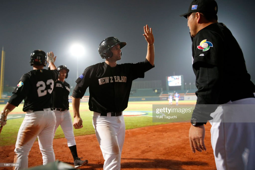 Scott Campbell #13 of Team New Zealand is greeted in the dugout after scoring a run in the top of the fifth inning during Game 5 of the 2013 World Baseball Classic Qualifier against Team Philippines at Xinzhuang Stadium in New Taipei City, Taiwan on Saturday, November 17, 2012.