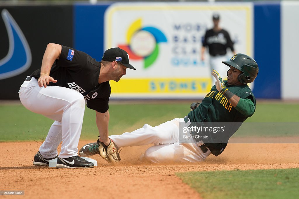 Scott Campbell of Team New Zealand tags out Brett Willemburg of Team South Africa on an attempted steal during Game 1 of the World Baseball Classic...