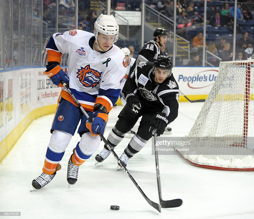 Scott Campbell #4 of the Bridgeport Sound Tigers skates against David Kolomatis #6 of the Manchester Monarchs during an American Hockey League game on February 23, 2013 at the Webster Bank Arena at Harbor Yard in Bridgeport, Connecticut.