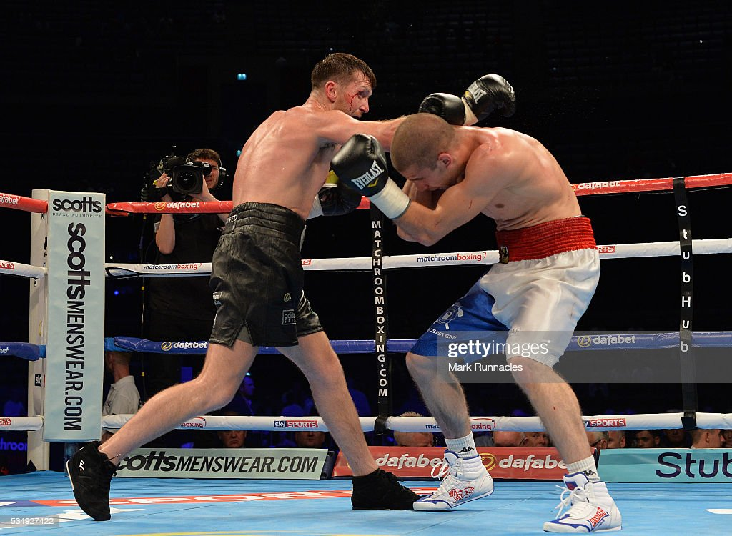 Scott Cardles (Black Shorts) and Ivan Njegac (Blue and White Shorts) during an undercard bout ahead of the WBA world super-lightweight title fight between Ricky Burns and Michele Di Rocco at The SSE Hydro on May 28, 2016 in Glasgow, Scotland.
