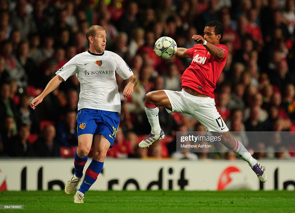 Scott Chipperfield of FC Basel and Nani of Manchester United