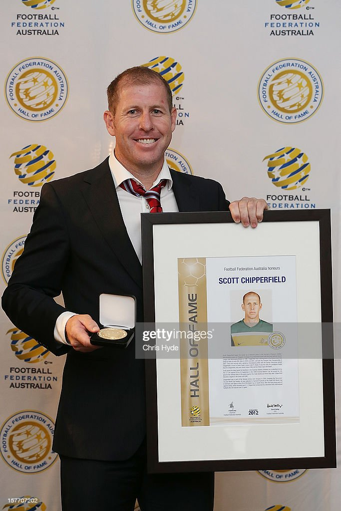 Scott Chipperfield poses with the Hall of Fame medal after being inducted into the 2012 Football Federation Australia Hall of Fame during a ceremony at Gambaro Restaurant and Function Centre on December 6, 2012 in Brisbane, Australia.