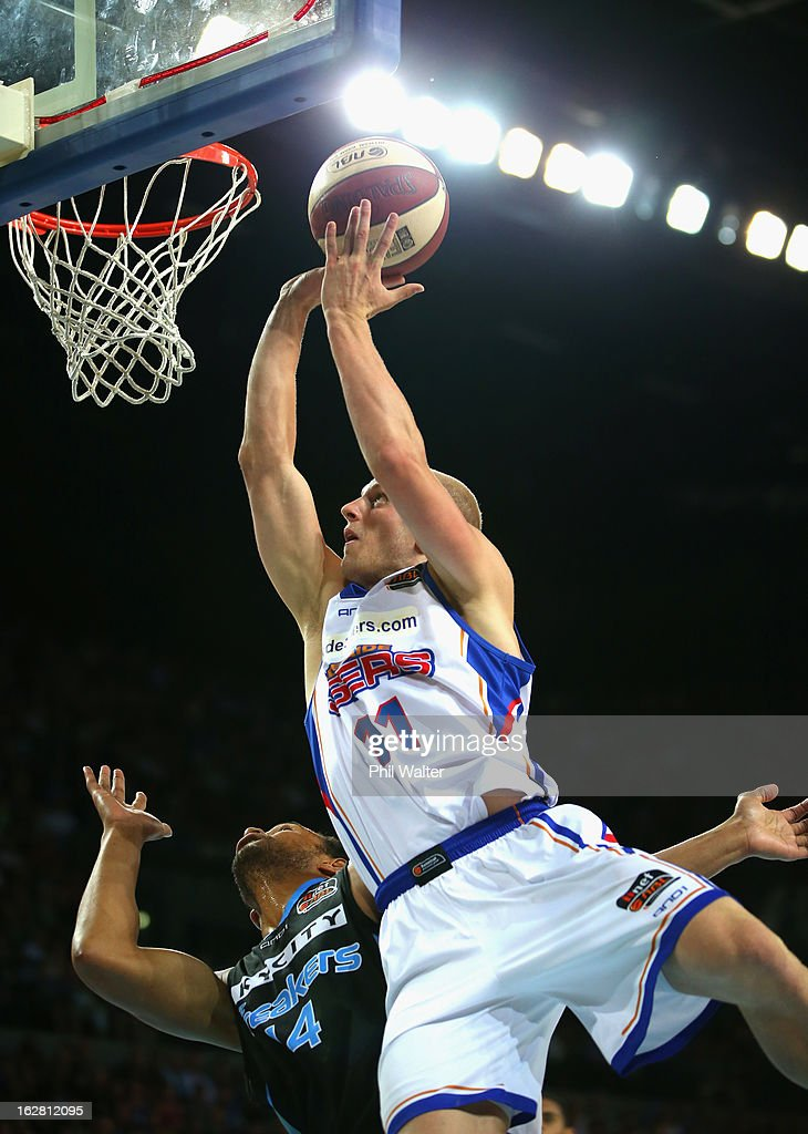 Scott Christopherson of the 36ers lays up the ball under pressure from Mika Vukona of the Breakers during the round 21 NBL match between the New Zealand Breakers and the Adelaide 36ers at Vector Arena on February 28, 2013 in Auckland, New Zealand.