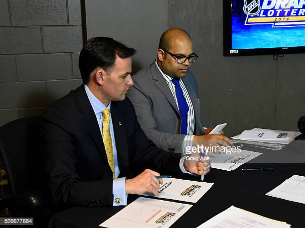 Scott Clarke and Lionel Coutinho of Ernst and Young prepare their list for the National Hockey League Draft Lottery at the CBC Studios in Toronto...