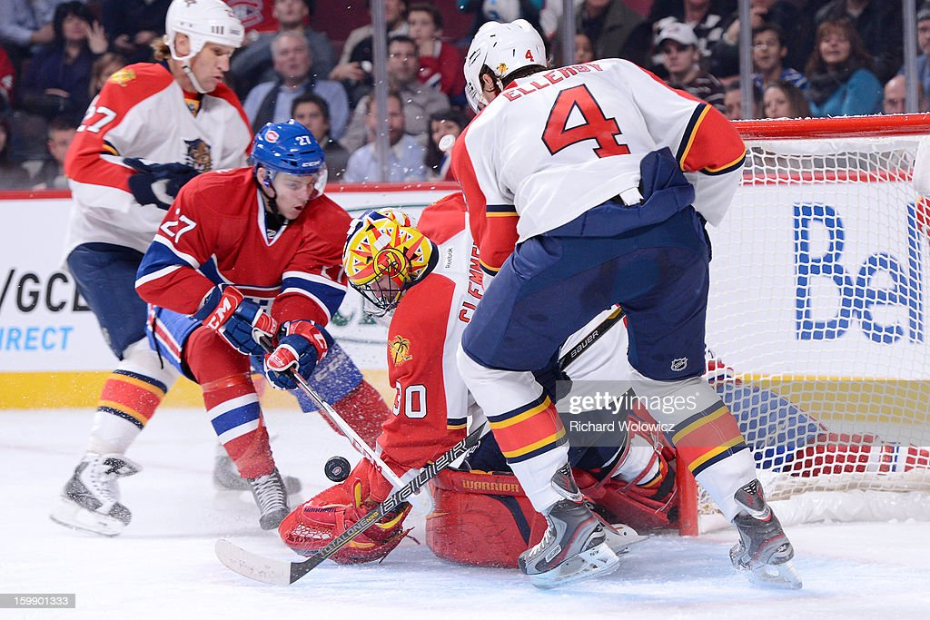 Scott Clemmensen #30 of the Florida Panthers stops the puck on an attempt by Alex Galchenyuk #27 of the Montreal Canadiens during the NHL game at the Bell Centre on January 22, 2013 in Montreal, Quebec, Canada. The Canadiens defeated the Panthers 4-1.