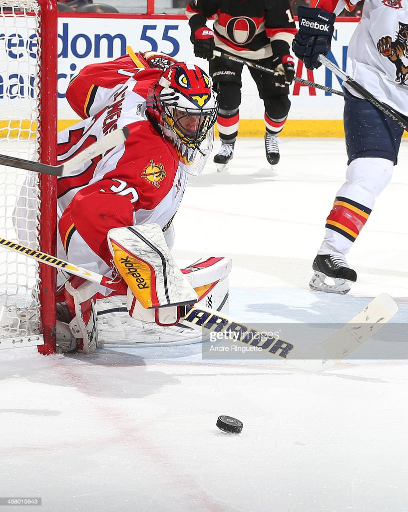 Scott Clemmensen of the Florida Panthers turns away the puck on one of his 32 saves in a game against the Ottawa Senators at Canadian Tire Centre on...