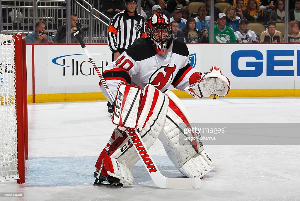 Scott Clemmensen of the New Jersey Devils defends the net against the Pittsburgh Penguins at Consol Energy Center on October 28 2014 in Pittsburgh...