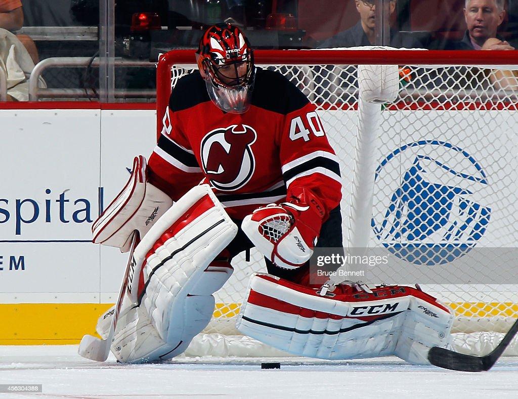 Scott Clemmensen of the New Jersey Devils tends net against the Philadelphia Flyers at the Prudential Center on September 28 2014 in Newark New...