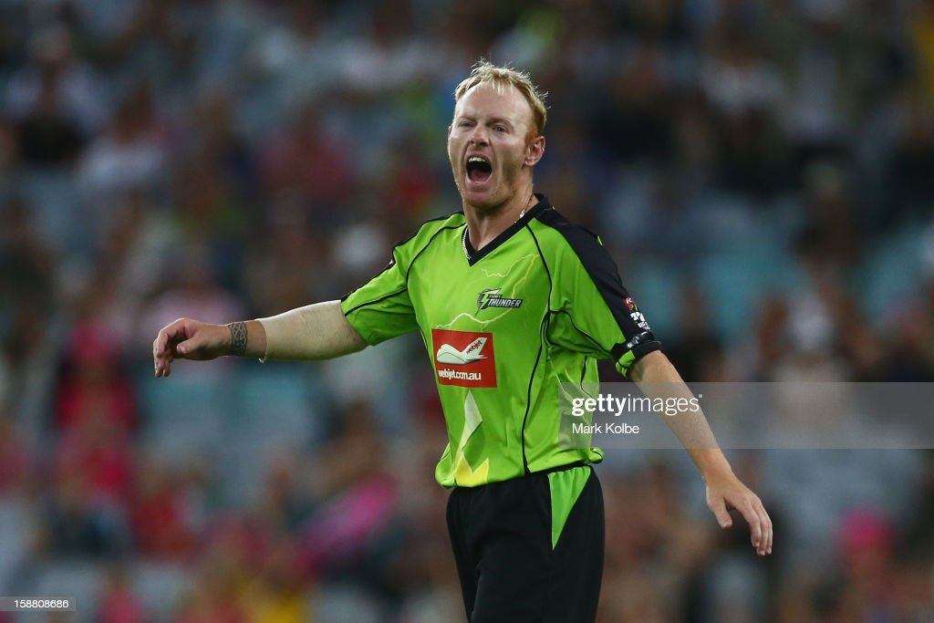 Scott Coyte of the Thunder looks dejected after dropping a catch in the second last over during the Big Bash League match between Sydney Thunder and the Sydney Sixers at ANZ Stadium on December 30, 2012 in Sydney, Australia.