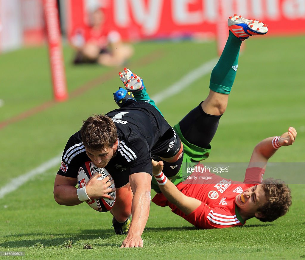 Scott Curry of New Zealand is tackled by Nuno Guedes of Portugal in the Dubai Cup Quarter Final match during the Emirates IRB Dubai Sevens, Round 2 of the HSBC Sevens World Series on December 1, 2012 in Dubai, United Arab Emirates.
