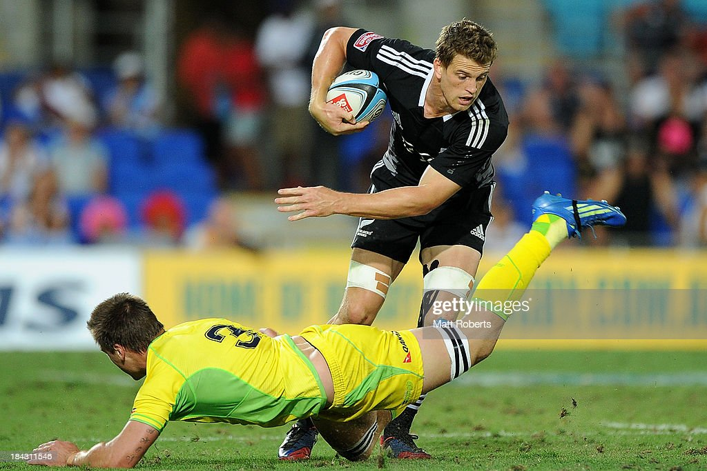 Scott Curry of New Zealand makes a break during the Gold Coast Sevens Cup final between Australia and New Zealand at Skilled Stadium on October 13, 2013 on the Gold Coast, Australia.