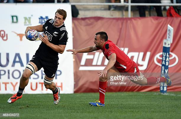 Scott Curry of New Zealand outruns Nicky Griffiths of Wales to score a try during the USA Sevens Rugby tournament at Sam Boyd Stadium on February 13...