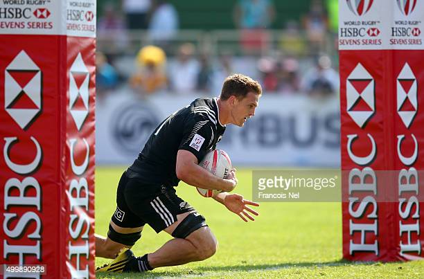 Scott Curry of New Zealand scores a try against France during the Emirates Dubai Rugby Sevens HSBC Sevens World Series on December 4 2015 in Dubai...