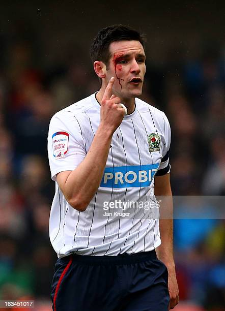 Scott Dann of Blackburn Rovers suggest an elbow was raised during the FA Cup sponsored by Budweiser sixth round match between Millwall and Blackburn...