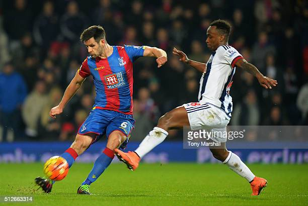 Scott Dann of Crystal Palace and Saido Berahino of West Bromwich Albion compete for the ball during the Barclays Premier League match between West...