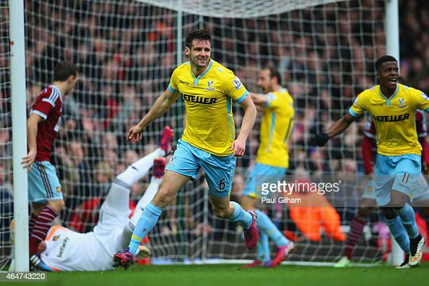 Scott Dann of Crystal Palace celebrates as he scores their second goal during the Barclays Premier League match between West Ham United and Crystal...