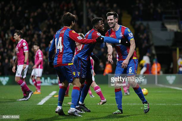 Scott Dann of Crystal Palace celebrates scoring his team's first goal with his team mates Wilfried Zaha and Lee Chungyong during the Barclays Premier...
