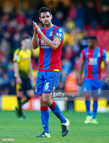 Scott Dann of Crystal Palace celebrates victory after the Barclays Premier League match between Watford and Crystal Palace at Vicarage Road on...