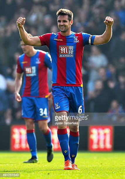 Scott Dann of Crystal Palace celebrates victory after the Barclays Premier League match between Crystal Palace and West Bromwich Albion at Selhurst...