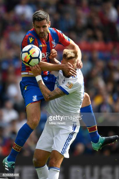 Scott Dann of Crystal Palace climbs all over Guido Burgstaller of Schalke during a Pre Season Friendly between Crystal Palace and FC Schalke 04 at...