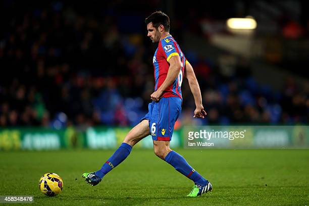 Scott Dann of Crystal Palace passes the ball during the Barclays Premier League match between Crystal Palace and Sunderland at Selhurst Park on...