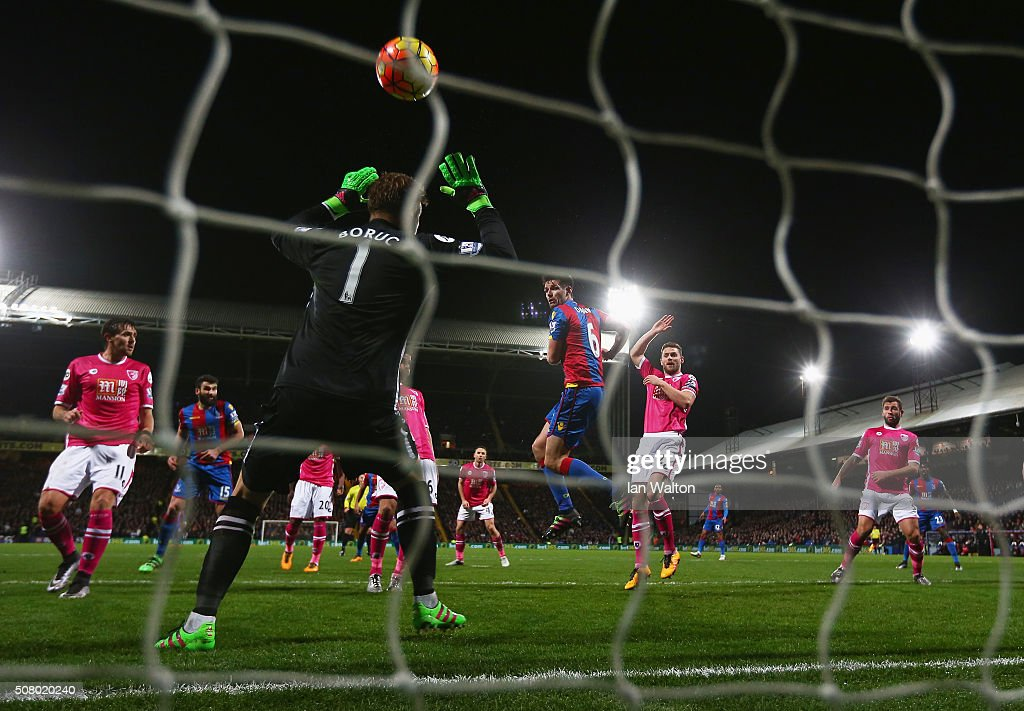 <a gi-track='captionPersonalityLinkClicked' href=/galleries/search?phrase=Scott+Dann&family=editorial&specificpeople=4210129 ng-click='$event.stopPropagation()'>Scott Dann</a> of Crystal Palace scores his team's first goal past <a gi-track='captionPersonalityLinkClicked' href=/galleries/search?phrase=Artur+Boruc&family=editorial&specificpeople=554761 ng-click='$event.stopPropagation()'>Artur Boruc</a> of Bournemouth during the Barclays Premier League match between Crystal Palace and A.F.C. Bournemouth at Selhurst Park on February 2, 2016 in London, England.