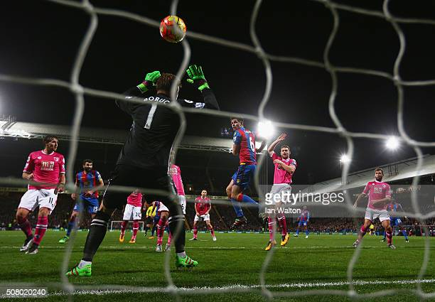 Scott Dann of Crystal Palace scores his team's first goal past Artur Boruc of Bournemouth during the Barclays Premier League match between Crystal...