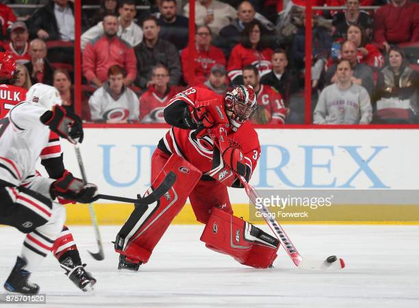 Scott Darling of the Carolina Hurricanes comes out of the crease to play the puck during an NHL game against the Chicago Blackhawks on November 11...